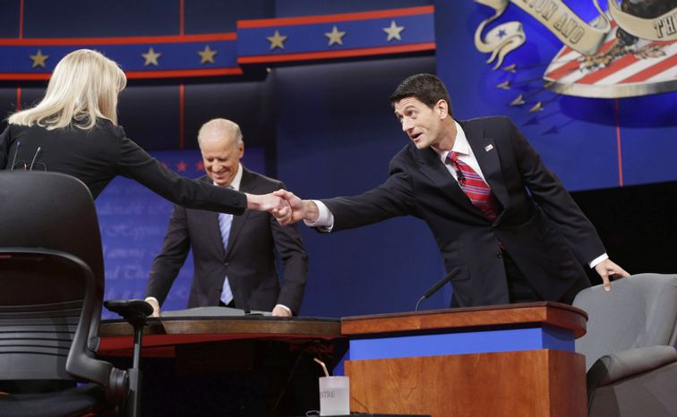 Moderator Martha Raddatz, left, reaches across to greet Republican vice presidential candidate, Rep. Paul Ryan, R-Wis., right, as Vice President Joe Biden, center, takes his seat for the start of the vice presidential debate. (AP Photo/Pablo Martinez Monsivais)