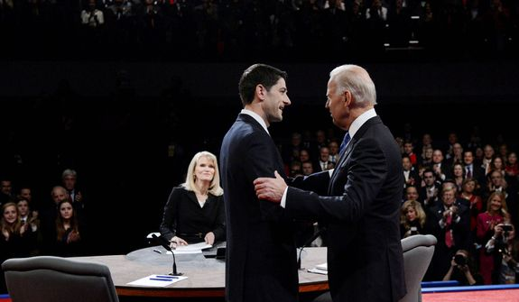 Moderator Martha Raddatz watches as Vice President Joe Biden and Republican vice presidential nominee Rep. Paul Ryan of Wisconsin shake hands before the vice presidential debate. (AP Photo/Pool-Michael Reynolds)