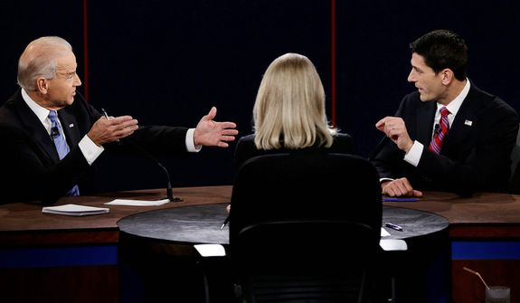 Vice President Joe Biden and Republican vice presidential nominee Rep. Paul Ryan of Wisconsin spar during the vice presidential debate. (AP Photo/Charlie Neibergall)