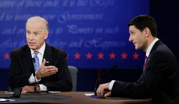 Vice President Joe Biden, left, and Republican vice presidential nominee Paul Ryan, of Wisconsin, speak during the vice presidential debate. (AP Photo/David Goldman)