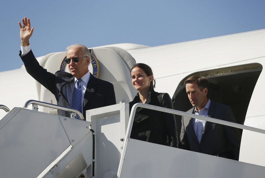 Vice President Joseph R. Biden (left), followed by his daughter Ashley and son Beau, exit Air Force Two on Oct. 11, 2012, upon their arrival at Lexington Blue Grass Airport in Lexington, Ky., for the vice presidential debate. (Associated Press)