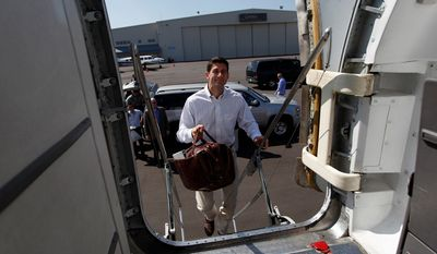 Republican vice presidential candidate Paul Ryan boards the campaign jet at Clearwater International Airport in Clearwater, Fla., on Oct. 10, 2012. (Associated Press