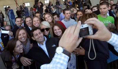 Republican vice presidential candidate Paul Ryan poses Oct. 10, 2012, for pictures with supporters as he arrives at the Blue Grass Airport in Lexington, Ky. (Associated Press)