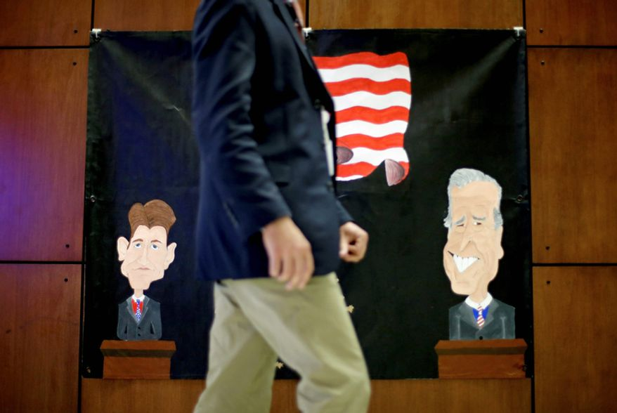 A banner made by a local middle school depicting Republican vice presidential candidate Paul Ryan and Vice President Joseph Biden hangs on the wall Oct. 10, 2012, inside the media center at Centre College in Danville, Ky. Biden and Ryan will debate at the college on Oct. 11. (Associated Press)