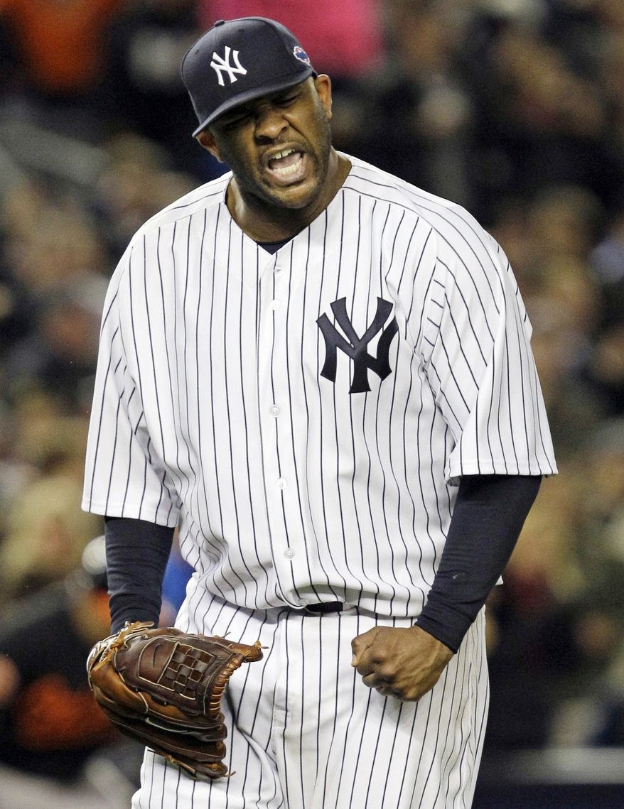 New York Yankees starting pitcher CC Sabathia reacts after Baltimore Orioles' J.J. Hardy grounded out to end the eighth inning of Game 5 of the American League division baseball series Friday, Oct. 12, 2012, in New York. The Yankees won the game 3-1. (AP Photo/Kathy Willens)