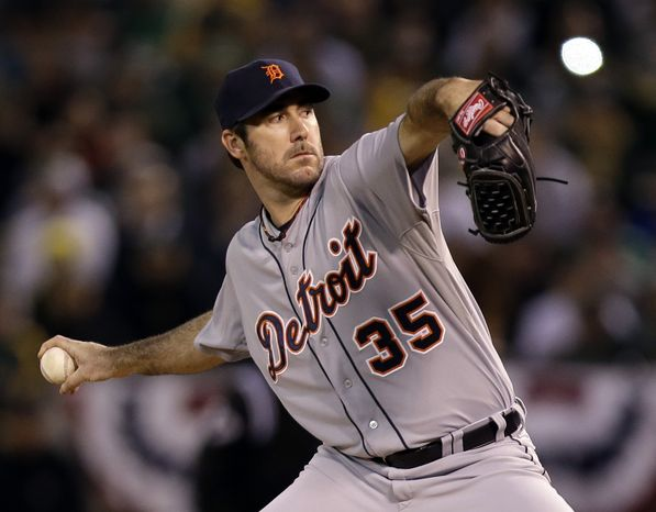 Detroit Tigers starting pitcher Justin Verlander delivers a pitch in the first inning of Game 5 of an American League division baseball series against the Oakland Athletics in Oakland, Calif., Thursday, Oct. 11, 2012.(AP Photo/Marcio Jose Sanchez)