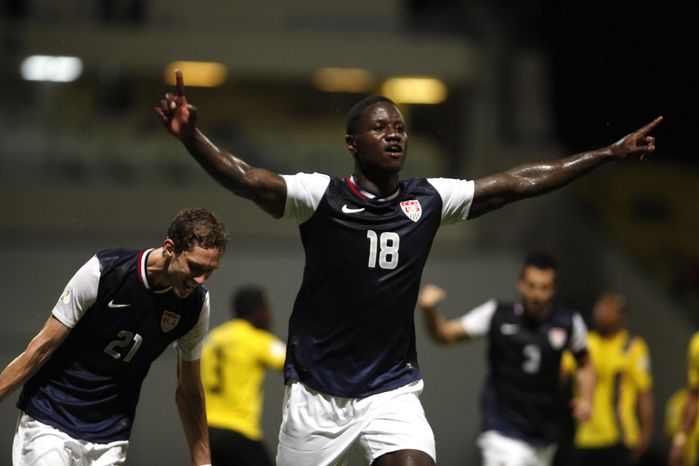 US Eddie Johnson, center, celebrates after scoring against Antigua and Barbuda during a 2014 World Cup qualifying soccer match in St. John, Antigua and Barbuda, Friday, Oct. 12, 2012. (AP Photo/Ric