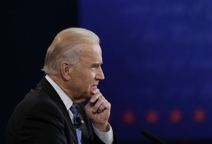 Vice President Joe Biden listens to Republican vice presidential nominee Rep. Paul Ryan, of Wisconsin, during the vice presidential debate at Centre College, Thursday, Oct. 11, 2012, in Danville, Ky. (AP Photo/Eric Gay)