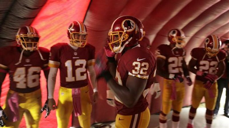 Washington Redskins defensive back Jordan Pugh waits to be introduced in the tunnel before the first half of an NFL football game against the Atlanta Falcons in Landover, Md., Sunday, Oct. 7, 2012. (AP Photo/Evan Vucci)