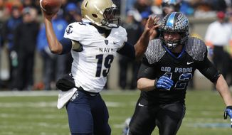 Keenan Reynolds (shown against Air Force) led Navy to a win over Central Michigan on Friday night. (Associated Press)