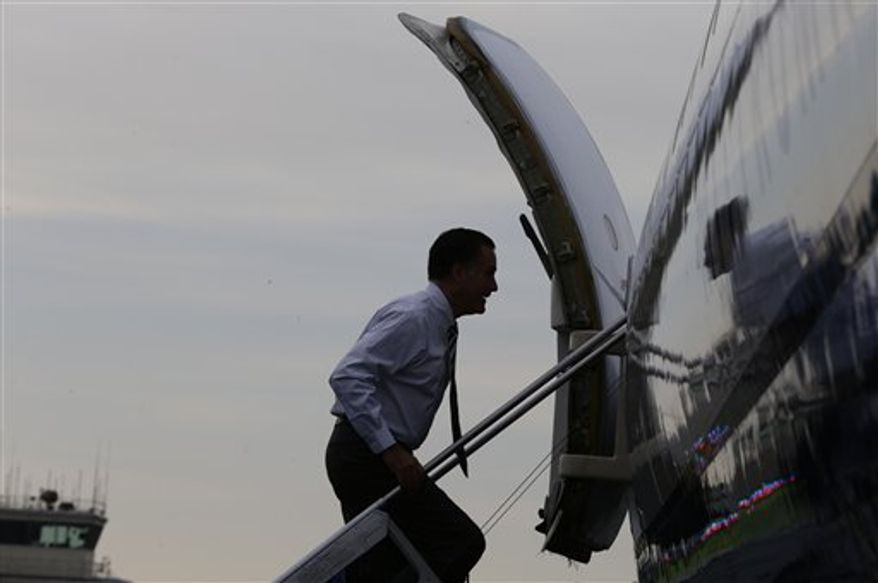 Republican presidential candidate and former Massachusetts Gov. Mitt Romney boards his campaign plane in Fletcher, N.C., Friday, Oct. 12, 2012. (AP Photo/Charles Dharapak)