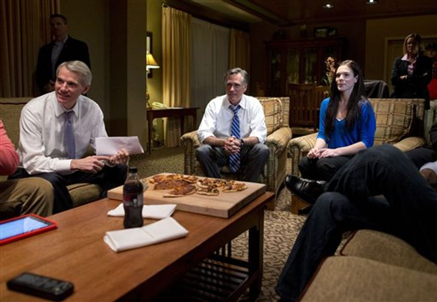 Republican presidential candidate, former Massachusetts Gov. Mitt Romney, center, watches the vice presidential debate in his hotel room on Thursday, Oct. 11, 2012, in Asheville, N.C.  (AP Photo/ Evan Vucci)