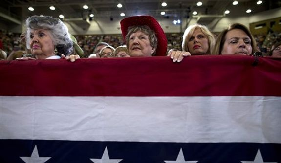 Supporters of Republican presidential candidate, former Massachusetts Gov. Mitt Romney listen to him speak during a campaign rally at the U.S. Cellular Center on Thursday, Oct. 11, 2012 in Asheville, N.C.  (AP Photo/ Evan Vucci)