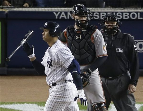 New York Yankees' Alex Rodriguez, left, reacts after striking out with two runners on base in the eighth inning of Game 4 of the American League division baseball series against the Baltimore Orioles, Thursday, Oct. 11, 2012, in New York. Orioles catcher Matt Wieters, center, umpire Fieldin Culbreth, right, look on. (AP Photo/Peter Morgan)