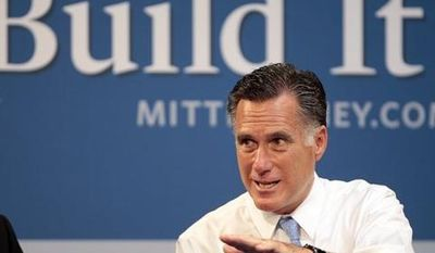 **FILE** Republican presidential candidate Mitt Romney hosts a small-business roundtable July 23, 2012, during a campaign stop at Endural LLC in Costa Mesa, Calif. (Associated Press)