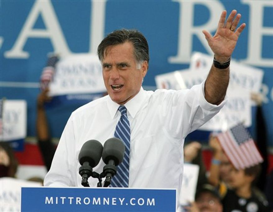 Republican presidential candidate and former Massachusetts Gov. Mitt Romney talks to supporters as he campaigns in Lebanon, Ohio, Saturday, Oct. 13, 2012. (AP Photo/Tom Uhlman)