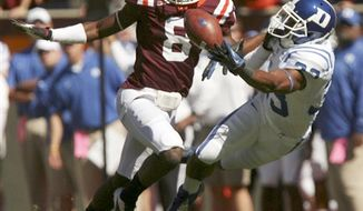 Duke wide receiver Desmond Scott (33) right, dives for the ball as Virginia Tech free safety Derrick Bonner (8) left, defends in the first quarter of an NCAA college football game in Blacksburg Va, Saturday Oct. 13, 2012. (AP Photo / the Roanoke Times, Matt Gentry)