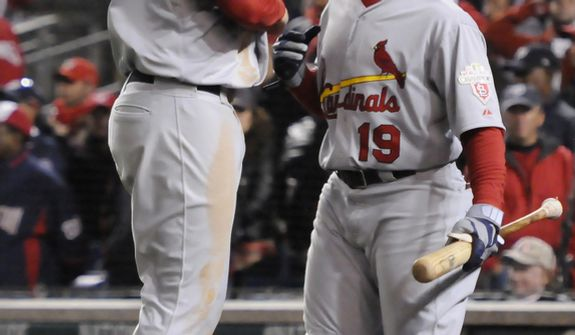 St. Louis Cardinals third baseman David Freese (23) celebrates with Jon Jay (19) after scoring in the top of the 9th inning, giving his team a 9-7 lead in Game 5 of the National League Division Series between the Washington Nationals and the St. Louis Cardinals at Nationals Park, Friday, October 12, 2012. (Preston Keres/Special to The Washington Times)