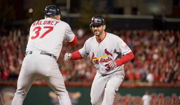 St. Louis Cardinals second baseman Daniel Descalso (33) drives in two run after hitting a hard single to center to tie the game 7-7 as the Washington Nationals play the St. Louis Cardinals in game five of the National League Division Series at Nationals Park, Washington, D.C., Saturday, October 13, 2012. (Andrew Harnik/The Washington Times)