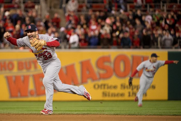 St. Louis Cardinals second baseman Daniel Descalso (33) celebrates after catching a pop up for the final out of the game as the Washington Nationals lose to the St. Louis Cardinals 9-7 in game five of the National League Division Series at Nationals Park, Washington, D.C., Saturday, October 13, 2012. (Andrew Harnik/The Washington Times)