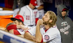 Washington Nationals center fielder Bryce Harper (34), left, and right fielder Jayson Werth (28), right, watch as the St. Louis Cardinals celebrate their win over the Washington Nationals in game five of the National League Division Series at Nationals Park, Washington, D.C., Saturday, October 13, 2012. (Andrew Harnik/The Washington Times)