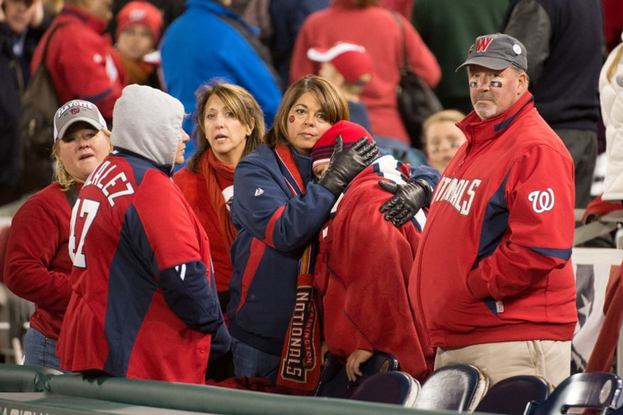 Washington Nationals fans watch as the Washington Nationals lose to the St. Louis Cardinals 9-7 in game five of the National League Division Series at Nationals Park, Washington, D.C., Saturday, October 13, 2012. (Andrew Harnik/The Washington Times)