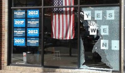 This photo provided by Courtney Grimm shows the shattered glass outside of President Barack Obama's Denver campaign office on Friday, Oct. 12, 2012. (AP Photo/Courtney Grimm)