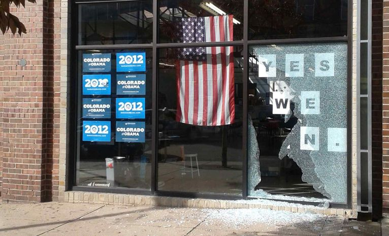 This photo provided by Courtney Grimm shows the shattered glass outside of President Barack Obama's Denver campaign office on Friday, Oct. 12, 2012. (AP Photo/Courtney Grimm