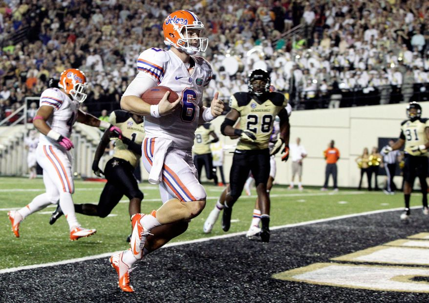 Florida quarterback Jeff Driskel (6) runs for a touchdown in the third quarter of an NCAA college football game against Vanderbilt on Saturday, Oct. 13, 2012, in Nashville, Tenn. Florida won 31-17. (AP Photo/Wade Payne)