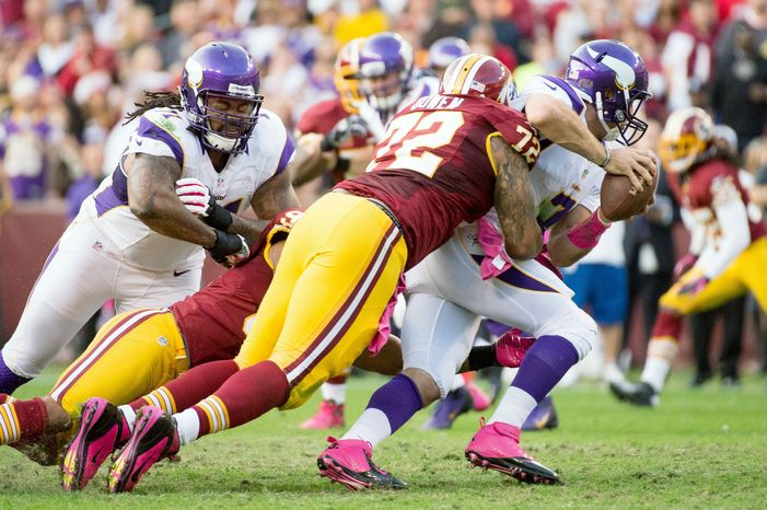 Minnesota Vikings quarterback Christian Ponder (7) is sacked by Washington Redskins defensive end Stephen Bowen (72) and Washington Redskins linebacker Lorenzo Alexander (97) at the end of the second quarter as the Washington Redskins play the Minnesota Vikings at FedEx Field, Landover, Md., Sunday, October 14, 2012. (Andrew Harnik/The Washington Times)