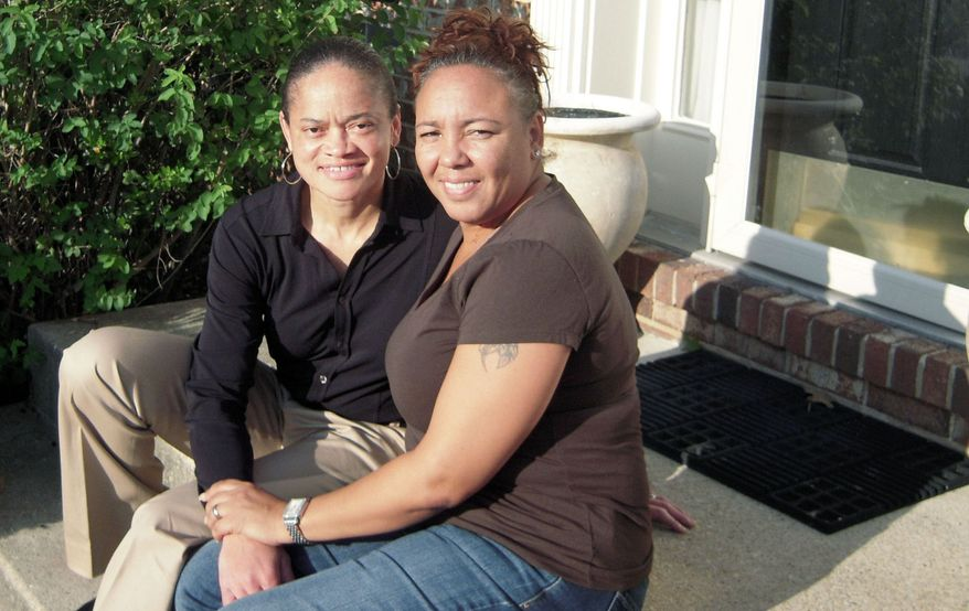 Irene Huskens (right) and partner Leia Burks sit on the front porch of their Bowie home Oct. 4. They plan to tie the knot at a Southern Maryland bed-and-breakfast if Marylanders vote to legalize same-sex marriage in a referendum on Nov. 6. (Associated Press)