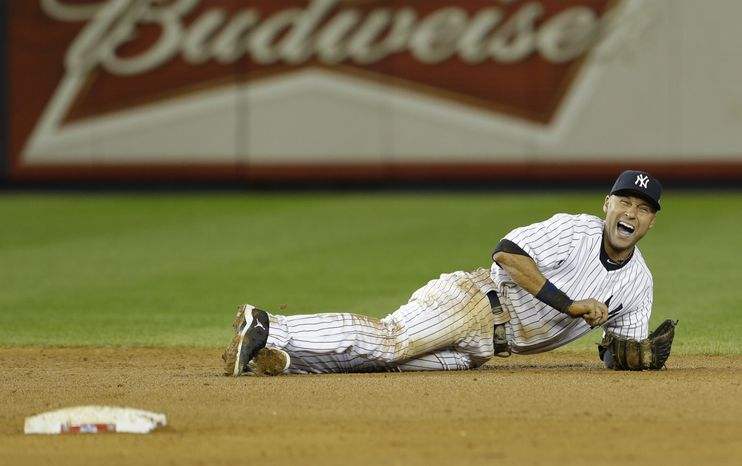 New York Yankees shortstop Derek Jeter reacts after injuring himself in the 12th inning of Game 1 of the American League championship series against the Detroit Tigers early on Sunday, Oct. 14, 2012, in New York. (AP Photo/Paul Sancya )