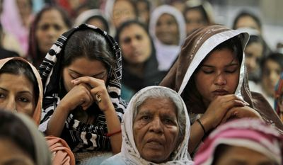 Pakistani Christians pray for the recovery of 14-year-old schoolgirl Malala Yousufzai, who was shot Tuesday by a Taliban gunman for speaking out in support of education for women, at the Sacred Heart Cathedral Church in Lahore, Pakistan, on Sunday, Oct. 14, 2012. (AP Photo/K.M. Chaudary)
