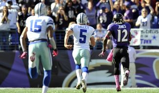 Baltimore Ravens' Jacoby Jones runs a kickoff back for a touchdown in the second half of an NFL football game against the Dallas Cowboys in Baltimore, Sunday, Oct. 14, 2012. Pictured chasing Jones are Dallas Cowboys kicker Dan Bailey (5) and wide receiver Andre Holmes. (AP Photo/Gail Burton)
