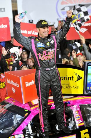 Clint Bowyer celebrates his win in Victory Lane after the NASCAR Sprint Cup Series auto race at Charlotte Motor Speedway, Saturday, Oct. 13, 2012, in Concord, N.C. (AP Photo/Autostock, Nigel Kinrade) MANDATORY CREDIT