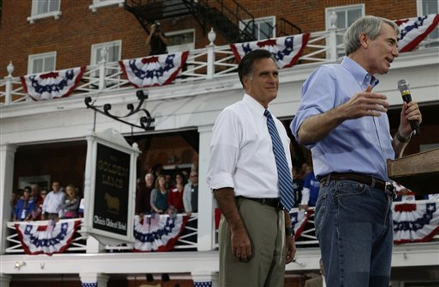 Republican presidential candidate and former Massachusetts Gov. Mitt Romney campaigns with Sen. Rob Portman, Ohio Republican, in front of The Golden Lamb inn and restaurant in Lebanon, Ohio, Saturday, Oct. 13, 2012. (AP Photo/Charles Dharapak)