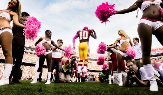Washington Redskins quarterback Robert Griffin III (10) is introduced before the game against the Minnesota Vikings. (Preston Keres/Special to The Washington Times)