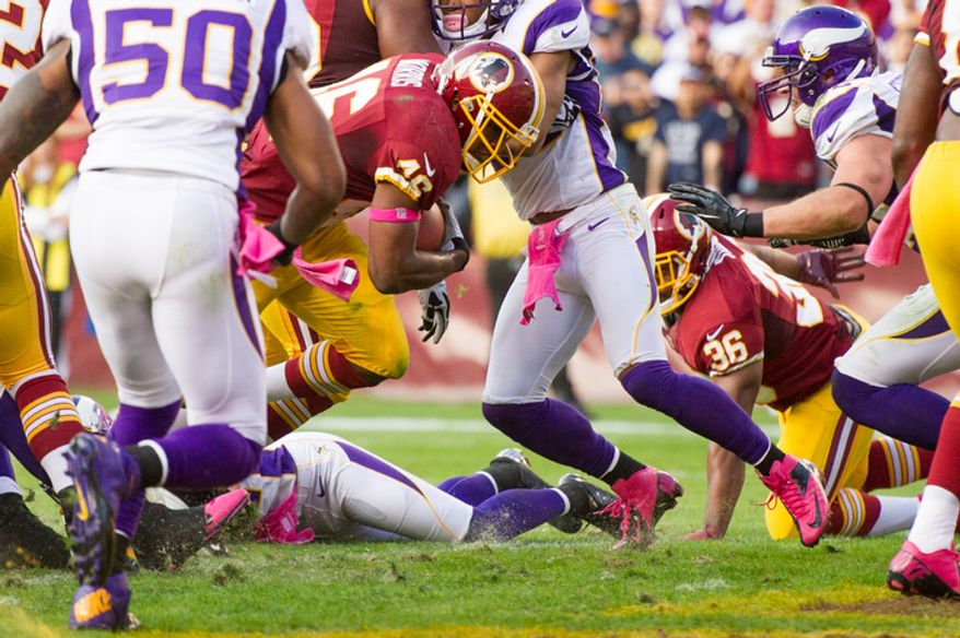 Washington Redskins running back Alfred Morris (46) scores in the second quarter on a one yard running play to tie the game 9-9 as the Washington Redskins play the Minnesota Vikings at FedEx Field. (Andrew Harnik/The Washington Times)