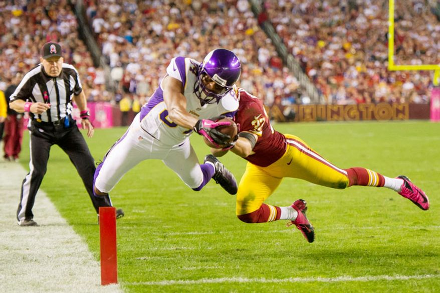 Minnesota Vikings wide receiver Michael Jenkins (84) scores on a 9 yard pass in the fourth quarter as the Washington Redskins play the Minnesota Vikings at FedEx Field. (Andrew Harnik/The Washington Times)