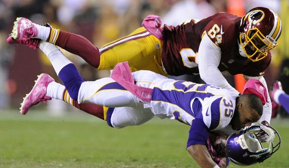 Minnesota Vikings cornerback Marcus Sherels' (35) helmet flies off as he is tackled by Washington Redskins Niles Paul (84) on a fourth quarter punt return for no gain. (Preston Keres/Special to The Washington Times)