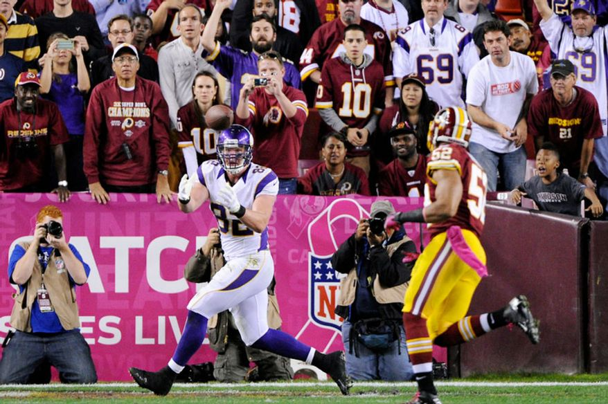Minnesota Vikings tight end Kyle Rudolph (82) hauls in one-yard touchdown in the fourth quarter in front of Washington Redskins linebacker Keenan Robinson (52) at FedEx Field. (Preston Keres/Special to The Washington Times)