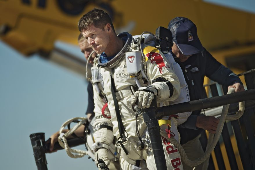 ** FILE ** Pilot Felix Baumgartner of Austria reacts after his mission was aborted in Roswell, N.M., on Tuesday, Oct. 9, 2012. (AP Photo/Red Bull Stratos, Joerg Mitter)