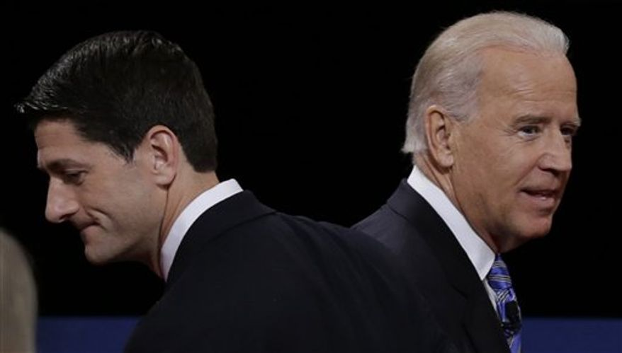Republican vice presidential nominee Rep. Paul Ryan of Wisconsin and Vice President Joe Biden pass each other after the vice presidential debate at Centre College, in this Oct. 11, 2012 photo taken in Danville, Ky. (AP Photo/Charlie Neibergall, File)