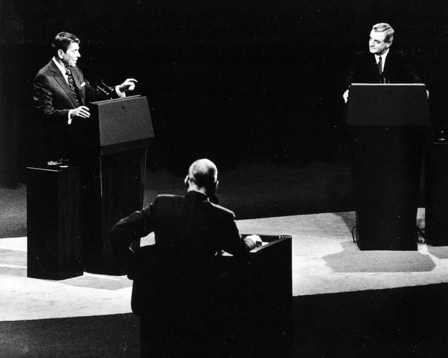 President Reagan (left) bested challenger Walter F. Mondale (right) in 1984 after Mr. Mondale promised he would raise taxes. (Associated Press)