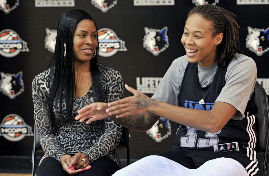 In this photo made Friday, Oct. 12, 2012, Minnesota Lynx WNBA basketball star and Olympic gold medalist Seimone Augustus talks about her relationship and engagement to LaTaya Varner, left,  during an interview with The Associated Press in Minneapolis. With a wedding scheduled for May and a crucial vote in November that threatens to ban gay marriage in Minnesota, the intensely private Augustus is speaking out.  (AP Photo/Jim Mone)