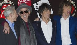 Rockers (from left) Charlie Watts, Keith Richards, Ronnie Wood and Mick Jagger of the British band the Rolling Stones arrive at a central London venue on Thursday, July 12, 2012, to mark the 50th anniversary of the group's first performance. (AP Photo/Jonathan Short)