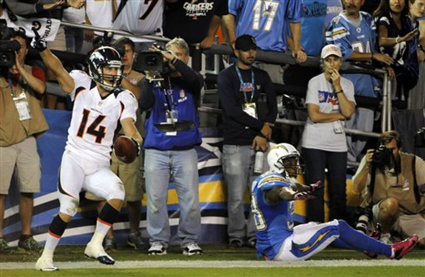 Denver Broncos wide receiver Brandon Stokley (14) reacts after scoring a touchdown as San Diego Chargers cornerback Marcus Gilchrist, right, motions to the referee during the second half of an NFL football game, Monday, Oct. 15, 2012, in San Diego. (AP Photo/Denis Poroy)