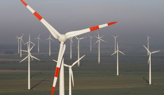 **FILE** Wind turbines produce green energy in Nauen near Berlin on Oct. 12, 2012. (Associated Press)
