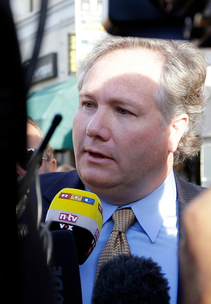 Lawyer John Arthur Eaves, representing a group of Costa Concordia survivors, is interviewed outside Teatro Moderno theater where the first hearing of the trial for the Jan. 13, 2012 tragedy, where 32 people died after the luxury cruise Costa Concordia was forced to evacuate some 4,200 passengers after it hit a rock while passing too close to the Giglio Island, is taking place, in Grosseto, Italy, Monday Oct. 15, 2012. (AP Photo/Gregorio Borgia)
