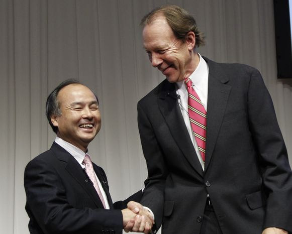 Softbank Corp. President Masayoshi Son (left) and Sprint Nextel Corp. Chief Executive Dan Hesse shake hands during their joint press conference in Tokyo on Monday, Oct. 15, 2012. Tokyo-based mobile carrier Softbank has reached a deal with Sprint to acquire 70 percent of the U.S. wireless company for $20.1 billion in the largest-ever foreign acquisition by a Japanese company. (AP Photo/Koji Sasahara)